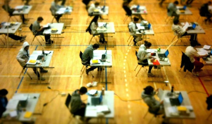 Students taking exams- top tips for studying