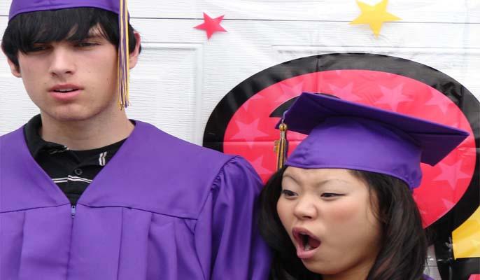 Graduates pulling funny faces