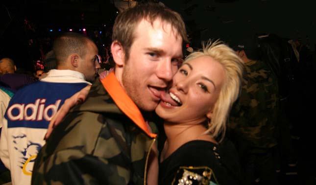 guy tonguing girl in club