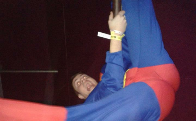 Fresher pole dancing in superman costume