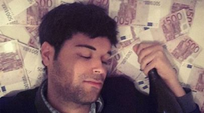 A young man asleep on a bed of 500 euro notes