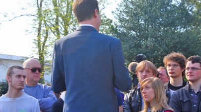 eu referendum politician giving speech to young unhappy voters