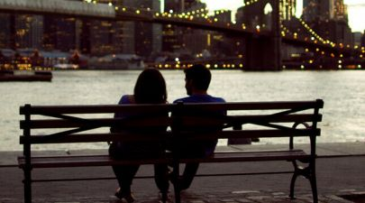 man and woman dating on a bench