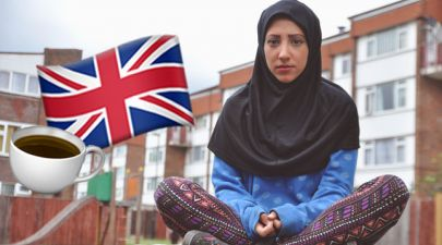 british muslim girl in hijab with flag and tea